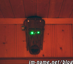 Wooden mask guy with motion activated green eyes